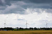 Wind turbines for wind power in meadow in rural Normandy, France