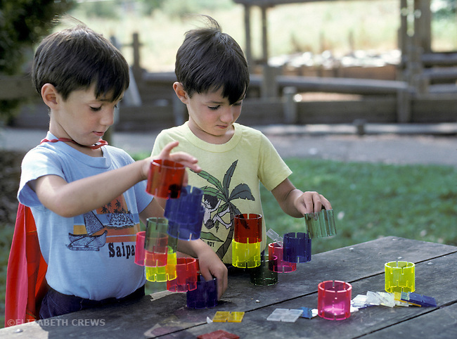 Berkeley CA Six-year-old identical twin boys doing construction project together  MR
