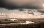 Marshland with the twisting estuary at Blakeney looking out to sea