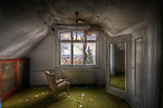 An old hotel in the Black Forest with chair beside window