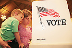 Los Altos Resident Missy Corbett and her son Jonah, 5, review their ballot together at the Masonic Hall in Los Altos, CA.