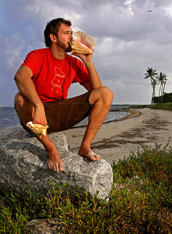 As a member of Suenalo Sound System and the Spam Allstars, Chad Bernsein blows a mean conch. The trombonist gets more sounds from the distinctive shell than you would think possible. Here he is photographed with two of his signature conch shells on Tuesday July 7, 2009.