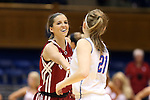 22 March 2014: Oklahoma's Morgan Hook (left) and DePaul's Megan Rogowski (21) shake hands before the game. The DePaul University Blue Demon played the University of Oklahoma Sooners in an NCAA Division I Women's Basketball Tournament First Round game at Cameron Indoor Stadium in Durham, North Carolina. DePaul won the game 104-100.