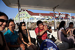 People taking pictures while riding the Aquabus at Shoreline Village in Rainbow Harbor, Long Beach, CA