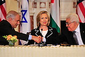"""United States Secretary of State Hillary Rodham Clinton, center, smiles as Prime Minister Benjamin Netanyahu of Israel, left, and Mahmoud Abbas of the Paqlestinian Authority shake hands following their remarks at the start of the """"Relaunch of Direct Negotiations Between the Israelis and Palestinians"""" in the Benjamin Franklin Room of the U.S. Department of State on Thursday, September 2, 2010.  .Credit: Ron Sachs / CNP.(RESTRICTION: NO New York or New Jersey Newspapers or newspapers within a 75 mile radius of New York City)"""