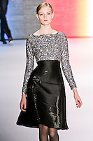 Nimue Smit walks runway in an outfit from the Carolina Herrera Fall 2011 collection, during Mercedes-Benz Fashion Week Fall 2011.