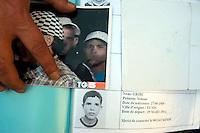 Roma 29  Marzo 2012.Una delegazione di famiglie tunisine arrivate in Italia per cercare i loro figli, che sono partiti a marzo su diverse imbarcazioni alla volta dell'Italia e poi sono spariti.I genitori mostrano le foto dove si vedono i figli scomparsi quando sono sbarcati  a Lampedusa