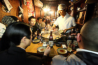 A chef cooks for his customers in a tiny restaurant in Tokyo, Japan, on November 5, 2006. Tokyo, seat of the Japanese government and home of the Japanese Imperial Family, is the Japanese capital, and is ranked fourth global city in the world. Photo by Lucas Schifres/Pictobank