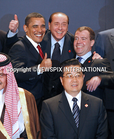 """G20 WORLD LEADERS.United States President Barack Obama, Prime Minister of Italy Silvio Berlusconi and President of the Russian Federation Dmitry Medvedev pose for the Heads of Delegation Family photograph before the start of the G20 Summit, Excel Centre, London_02/04/2009.Photo: Newspix International..**ALL FEES PAYABLE TO: """"NEWSPIX INTERNATIONAL""""**..PHOTO CREDIT MANDATORY!!: NEWSPIX INTERNATIONAL(Failure to credit will incur a surcharge of 100% of reproduction fees)..IMMEDIATE CONFIRMATION OF USAGE REQUIRED:.Newspix International, 31 Chinnery Hill, Bishop's Stortford, ENGLAND CM23 3PS.Tel:+441279 324672  ; Fax: +441279656877.Mobile:  0777568 1153.e-mail: info@newspixinternational.co.uk"""