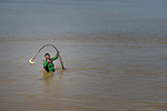 A Wichi indigenous man uses a net to catch a fish in the Pilcomayo River in Santa Victoria Este, Argentina. The Wichi in this area, largely traditional hunters and gatherers, have struggled for decades to recover land that has been systematically stolen from them by cattleraisers and large agricultural plantations, and to preserve their access to a river which has suffered increasing levels of contamination from upstream mining and other uses. After years of negotiation supported by Church World Service, a landmark 2014 agreement will divide the land in this region between indigenous communities and settlers, guaranteeing the survival of the Wichi and their access to the river.
