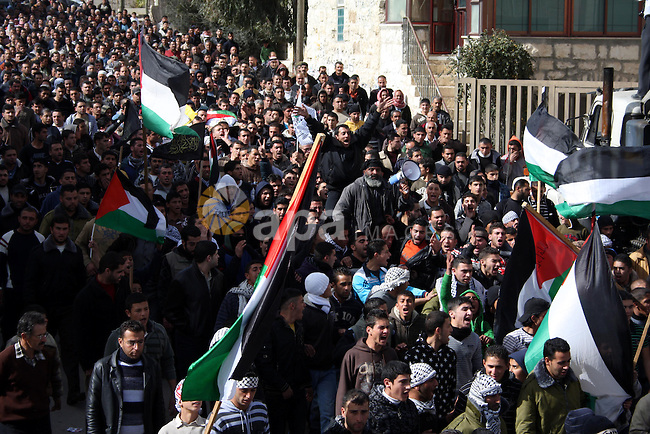 Palestinians carry the body of Youssef Ekhaleil during his funeral in the West Bank village of Beit Omar, near Hebron, Saturday, Jan. 29, 2011. Ekhaleil died from wounds sustained during a clash with settlers on Friday Photo by Najeh Hashlamoun