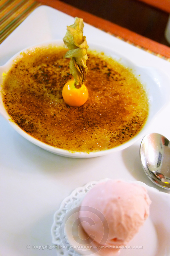 Hotel Residence in Nissan-lez-Enserune La Clape. Languedoc. Creme brulee with physalis and chewing gum flavoured ice cream. France. Europe.