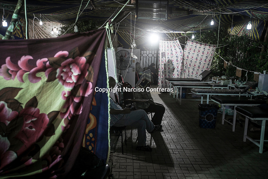 In this Thursday, Aug. 08, 2013 photo, out patients ward at the field hospital of the sit-in at Al-Raba'a Alawya in the Nasr district of Cairo. (Photo/Narciso Contreras).