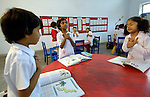 Students pray at the beginning of class at the Lucie Harrison Girls School in Lahore, run by the Church of Pakistan.