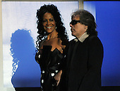 "Washington, DC - October 13, 2009 -- Sheila E. and Jose Feliciano walk on to the stage to perform at a White House Music Series ""Fiesta Latina"" with United States President Barack Obama on the South Lawn of the White House in Washington on Tuesday, October 13, 2009..Credit: Alexis C. Glenn / Pool via CNP"