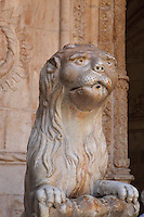 Stone lion with water spout mouth on a font in the corner of the Cloister, built in Manueline style by Diogo Boitac, Joao de Castilho and Diogo de Torralva, completed 1541, in the Jeronimos Monastery or Hieronymites Monastery, a monastery of the Order of St Jerome, built in the 16th century in Late Gothic Manueline style, Belem, Lisbon, Portugal. The cloister wings have wide arcades with rectangular column and tracery within the arches. The monastery is listed as a UNESCO World Heritage Site. Picture by Manuel Cohen