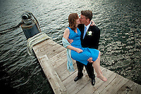 Dina and Mark share a kiss on the dock after being married aboard the Skansonia on Seattle's Lake Union. (Photo by Dan DeLong/Red Box Pictures)