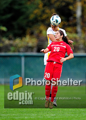 14 October 2010: University of Hartford Hawks forward/midfielder Amelia Pereira, a Sophomore from Madeira Island, Portugal, jumps for a header against University of Vermont Catamount midfielder/forward Gabby Bonfigli, a Senior from Essex Junction, VT, at Centennial Field in Burlington, Vermont. The Hawks defeated the Lady Cats 6-2 in America East play. Mandatory Credit: Ed Wolfstein Photo