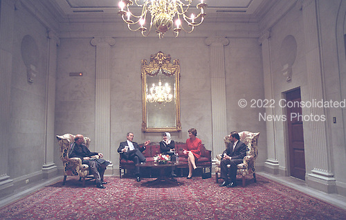 United States President George W. Bush and first lady Laura Bush meet with Hamid Karzai, Chairman of the Afghan Interim Authority (far left), and Dr. Sima Samar, Minister of Women's Affairs (center, right) at the U.S. Capitol prior to delivering his State of the Union Address, Tuesday, January 29, 2002..Mandatory Credit: Eric Draper - White House via CNP.