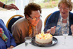 Mary Caulfield blows the candles out on her birthday cake in the tent during the Caulfield family reunion at the Caulfield home in Granlahan, County Roscommon, Ireland on Tuesday, June 25th 2013. (Photo by Brian Garfinkel)