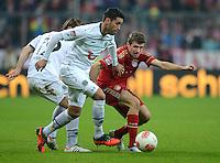 FUSSBALL   1. BUNDESLIGA  SAISON 2012/2013   13. Spieltag FC Bayern Muenchen - Hannover 96     24.11.2012 Karim Haggui (li, Hannover 96) gegen Thomas Mueller (FC Bayern Muenchen)
