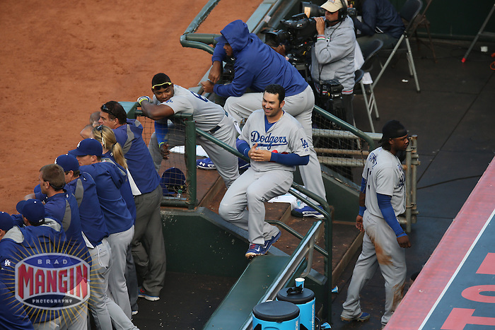 SAN FRANCISCO, CA - JULY 27:  Yasiel Puig amd Adrian Gonzalez of the Los Angeles Dodgers talk in the dugout during the game against the San Francisco Giants at AT&T Park on Sunday, July 27, 2014 in San Francisco, California. (Photo by Brad Mangin)