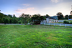 Dry Mill Winery is surrounded by neatly cut and trimmed yard and gardens.