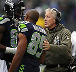 Seattle Seahawks  Head Coach Pete Carroll, right, talks to wide receivers Ricardo Lockette (83) and Doug Baldwin (83) before their game against the New York Giants at CenturyLink Field in Seattle, Washington on November 9, 2014. The Seahawks  beat the Giants 38-17.©2014. Jim Bryant Photo. All rights Reserved.