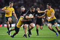 Dane Coles of New Zealand takes on the Australia defence. Rugby World Cup Final between New Zealand and Australia on October 31, 2015 at Twickenham Stadium in London, England. Photo by: Patrick Khachfe / Onside Images