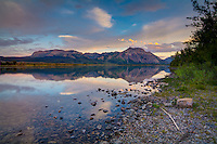 Sofa Mountain in Alberta's Waterton Lakes National Park on a beautiful summer evening photographed from across Lower Waterton Lake.