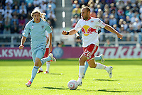 Joel Lindpere (20) Red Bulls midfielder drives at the KC goal watched by Sporting KC defender Chance Myers (7)... Sporting Kansas City defeated New York Red Bulls 2-1 at LIVESTRONG Sporting Park, Kansas City, Kansas.