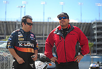 Apr. 1, 2012; Las Vegas, NV, USA: NHRA funny car driver Cruz Pedregon (right) talks with his brother Tony Pedregon during the Summitracing.com Nationals at The Strip in Las Vegas. Mandatory Credit: Mark J. Rebilas-