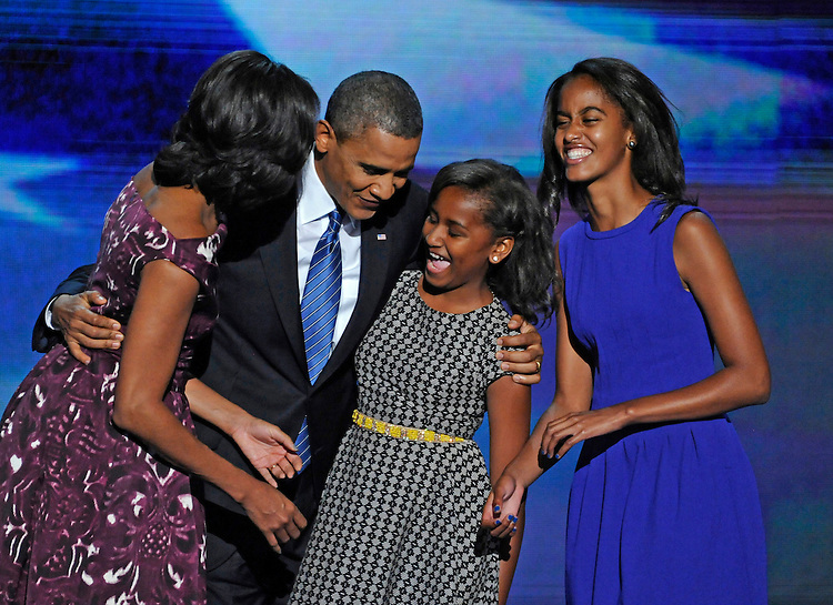 First Lady Michelle, left, President Barack Obama and their children Malia, and Sasha celebrate during the Democratic National Convention in Charlotte, North Carolina on Thursday, September 06, 2012.