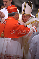Brazilian cardinal Orani Joao Tempesta receives his beret as he is being appointed cardinal by Pope Francis  at the consistory in the St. Peter's Basilica at the Vatican on February 22, 2014.