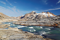 Glacial melt river and mountains, Sammileq Fjord, Ammassalik Island, East Greenland