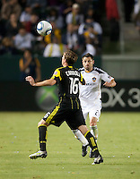 Columbus Crew midfielder Brian Carroll (16) readies to head the ball with pressure from Galaxy midfielder Dema Kovalenko (21) during the second half of the game between LA Galaxy and the Columbus Crew at the Home Depot Center in Carson, CA, on September 11, 2010. LA Galaxy 3, Columbus Crew 1.