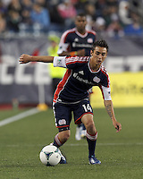 New England Revolution midfielder Diego Fagundez (14) controls the ball. In a Major League Soccer (MLS) match, the New England Revolution (blue) tied New York Red Bulls (white), 1-1, at Gillette Stadium on May 11, 2013.