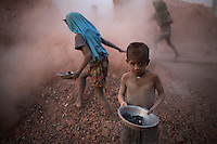 Children at a brick factory in Fatullah. For each thousand bricks they carry, they earn the equivalent of 0.9 USD. 17.5 percent of all children aged between 5-15 are engaged in economic activities. The average child labourer earns between 400 to 700 taka (1 USD = 70 taka) per month, while an adult worker earns up to 5,000 taka per month..
