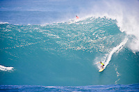 Bruce Irons (HAW) on his winning 100 point wave. The 2004 Quiksilver Eddie Aikau Big Wave Invitational won by Hawaiian surfer Bruce Irons (HAW) from the island of Kauai was held in 30 to 40' waves at Waimea Bay on the North Shore of Oahu Hawaii, today, December 15th 2004. Irons rode one of the biggest waves of the day which was at least 30' in height, taking home US$55,000 in prize money.  Photo: Joliphotos.com