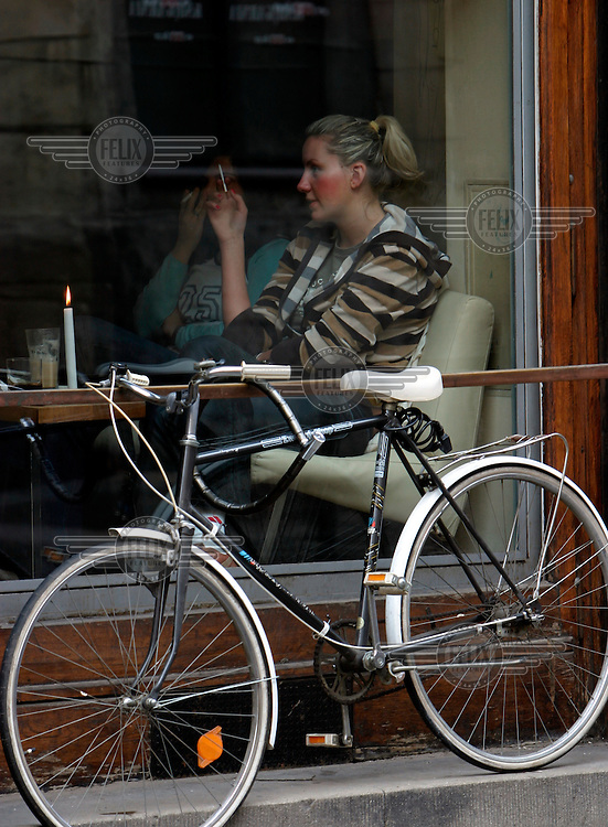Bicycle parked outside a cafe.
