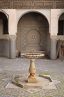 Fountain in the Courtyard of the Harem, Glaoui Palace, early 19th century, in Fes, Fes-Boulemane, Northern Morocco. The room has a central fountain, zellige tilework and a carved balcony which is damaged and in need of restoration. Thami Glaoui, Pasha of Marrakech, used this as his Fes residence. The complex consists of 30 fountains, 17 houses, 2 hammams, an oil mill, a mausoleum and cemetery, a madrasa, gardens and stables. Picture by Manuel Cohen