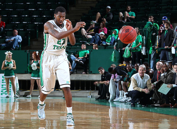 DENTON, TX - DECEMBER 16:  Jordan Williams #23 of the North Texas Mean Green passes the ball against the Southeastern Louisiana Lions at the UNT Coliseum on December 16, 2012 in Denton, Texas. (Photo by Rick Yeatts/Getty Images)