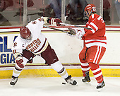Bill Arnold (BC - 24), Adam Clendening (BU - 4) - The Boston College Eagles defeated the visiting Boston University Terriers 5-2 on Saturday, December 4, 2010, at Conte Forum in Chestnut Hill, Massachusetts.