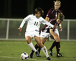 7 November 2007: Florida State's Mami Yamaguchi (11) holds off a Boston College defender. Florida State University defeated Boston College 1-0 at the Disney Wide World of Sports complex in Orlando, FL in an Atlantic Coast Conference tournament quarterfinal match.