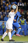 12 December 2014: Providence's Mark Jecewiz (15) and UCLA's Abu Danladi (GHA) (9). The University of California Los Angeles Bruins played the Providence College Friars at WakeMed Stadium in Cary, North Carolina in a 2014 NCAA Division I Men's College Cup semifinal match.