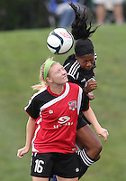 BOYDS, MARYLAND - July 21, 2012:  Tiffany Brown (9) of DC United Women heads the ball away from Megan Weston (16) of the Virginia Beach Piranhas during a W League Eastern Conference Championship semi final match at Maryland Soccerplex, in Boyds, Maryland on July 21. DC United Women won 3-0.