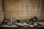 A Marine from of Alpha Co. 1st Battalion 6th Marines catches a little shut eye at the company's observation post in Ramadi, Iraq on Fri. Oct. 13, 2006.<br />