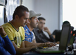 Syrian men learn computer skills in a program run by the Lutheran World Federation in the Zaatari refugee camp near Mafraq, Jordan. Established in 2012 as Syrian refugees poured across the border, the camp held more than 80,000 refugees by 2015, and was rapidly evolving into a permanent settlement. The Lutheran World Federation is a member of the ACT Alliance, which provides a variety of services to refugees living in the camp.