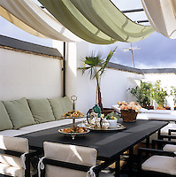 This roof terrace is shielded by a canvas canopy