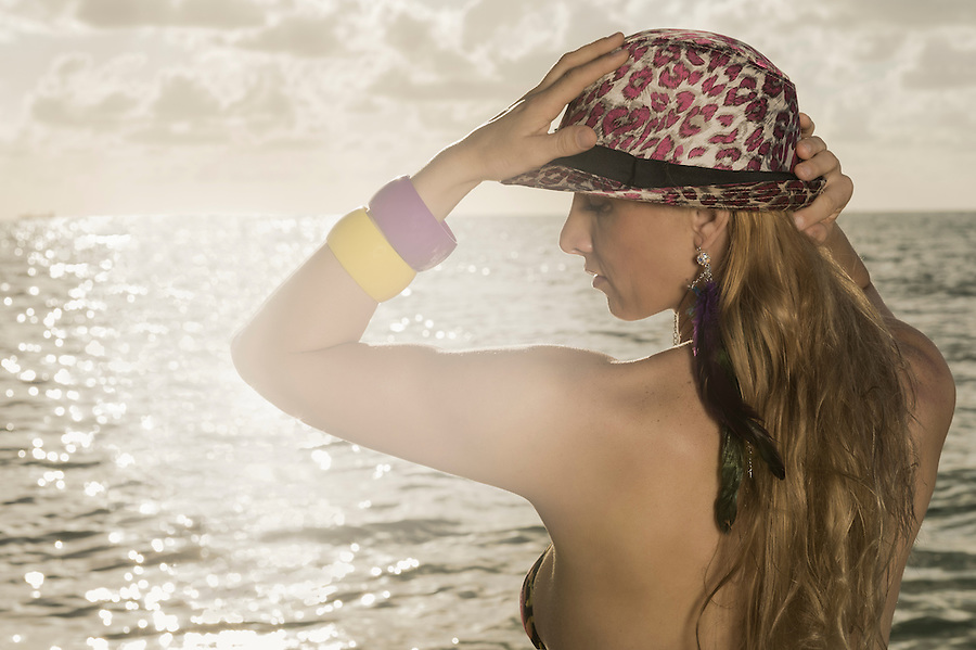 Portrait of young caucasian woman sunset time on the beach.